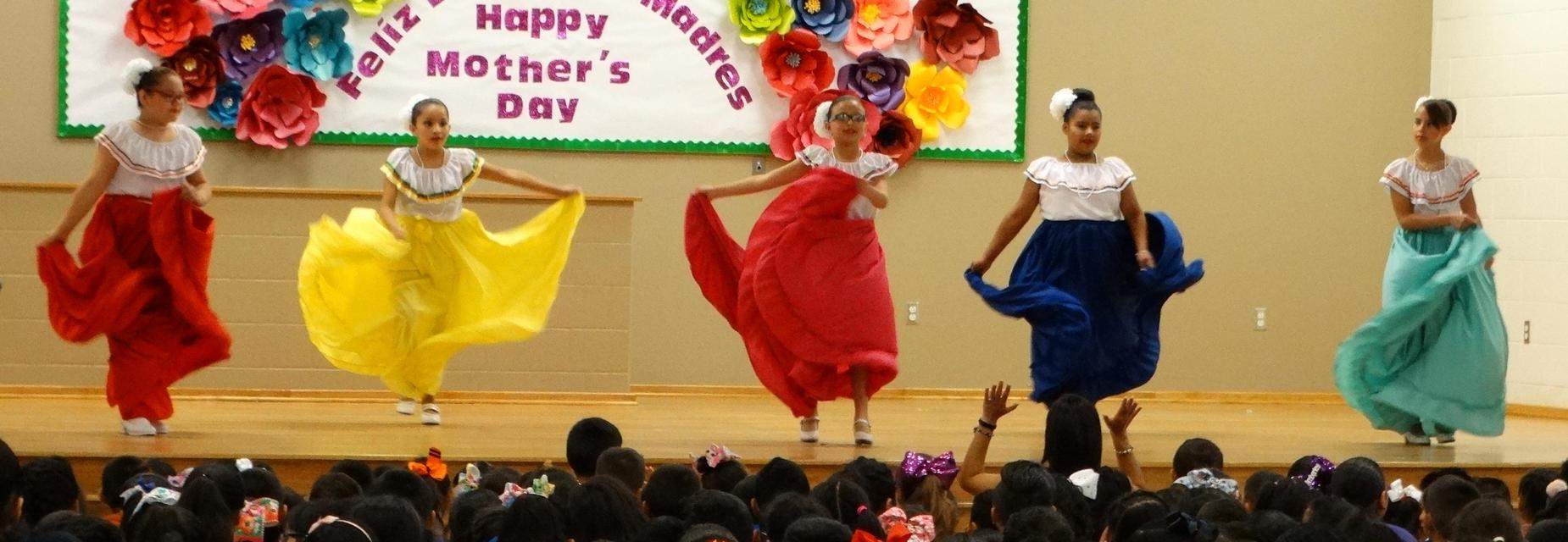 Folklorico girls on stage dancing