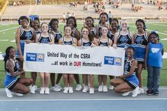 cheerleaders holding United Way sign