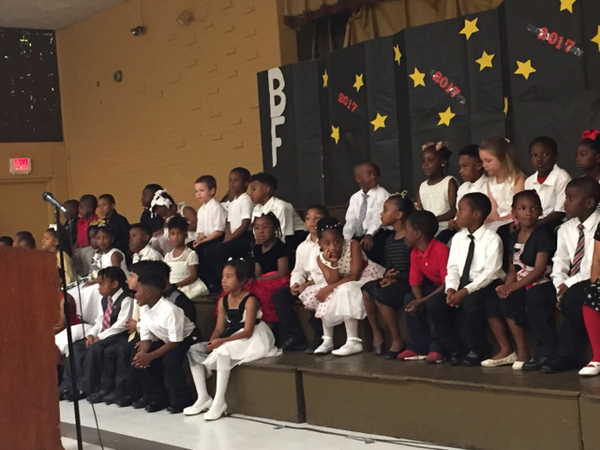 Photo of Bakerfield and Baker Heights Kindergarten students on stage for their awards and graduation program