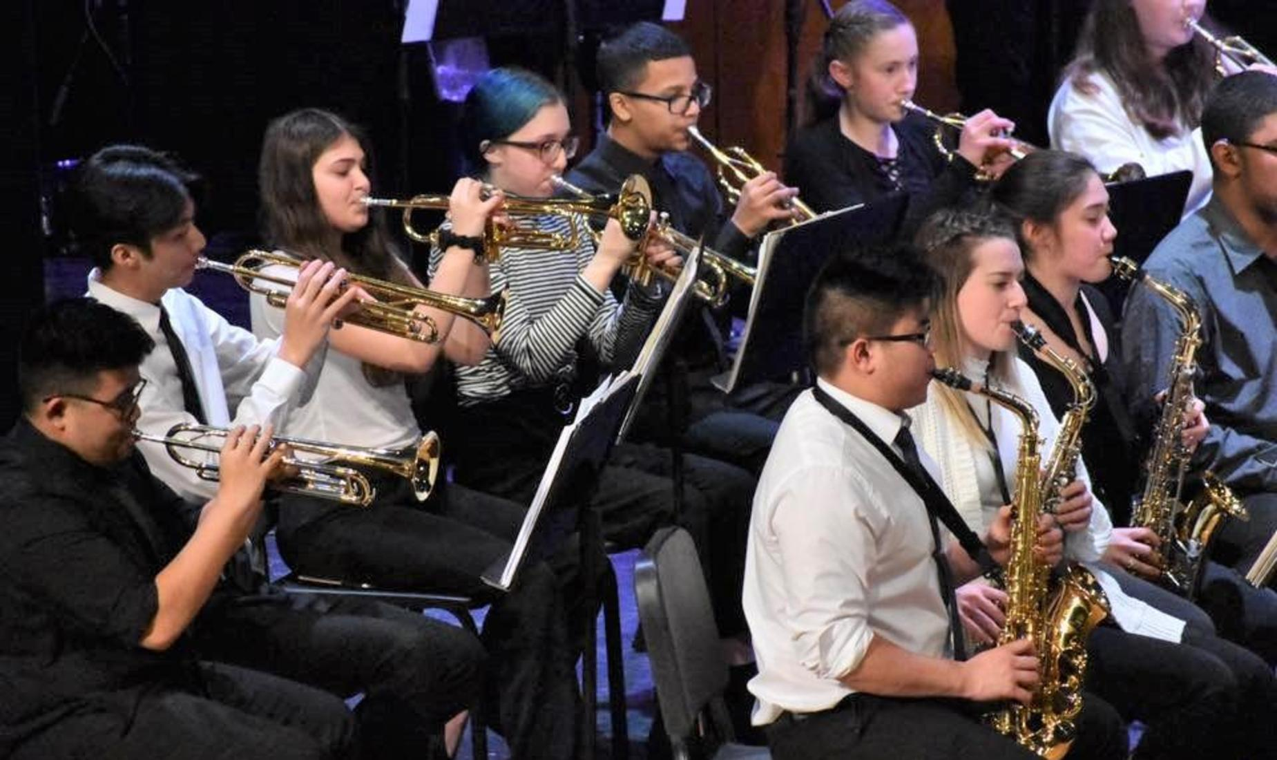 Boys and girls in the wind section performing at their spring concert