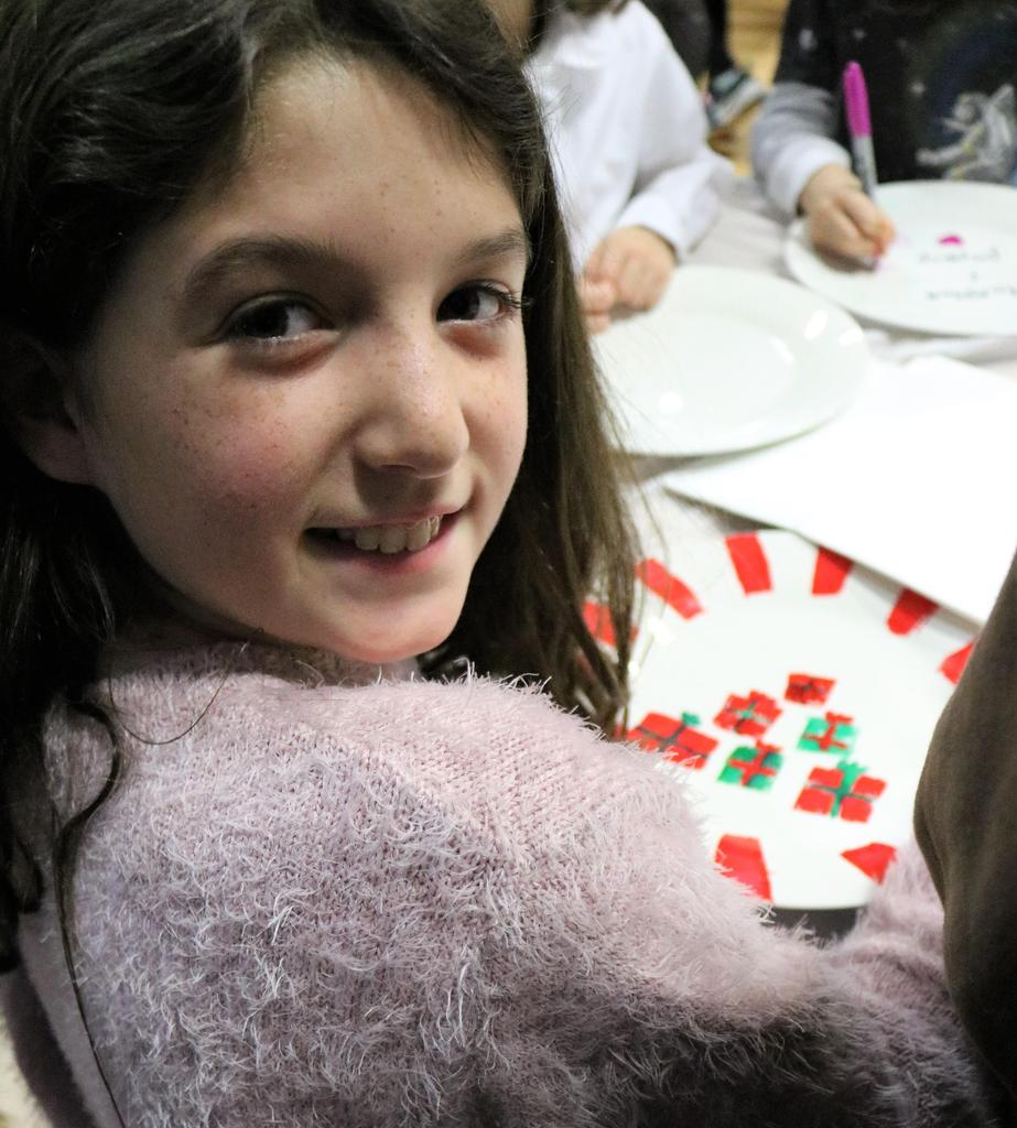 Photo of McKinley student participating in afterschool Handmade Holiday to create handmade crafts and gifts.
