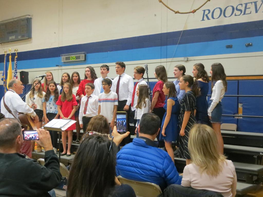 Photo of Roosevelt Chorus singing at Veterans Day Assembly.