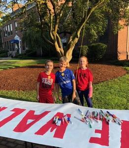Franklin students sign banner on Walk to School Day.