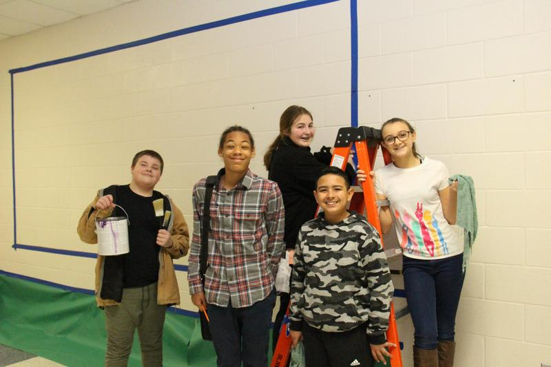 AVID students at B-L Middle School prepare to paint a mural on one of the walls of the 6th grade hall.  From left to right are Cooper Beck, Donaven Alewine, Laiken Brock, Johan Salinas and Chelsey Steele.