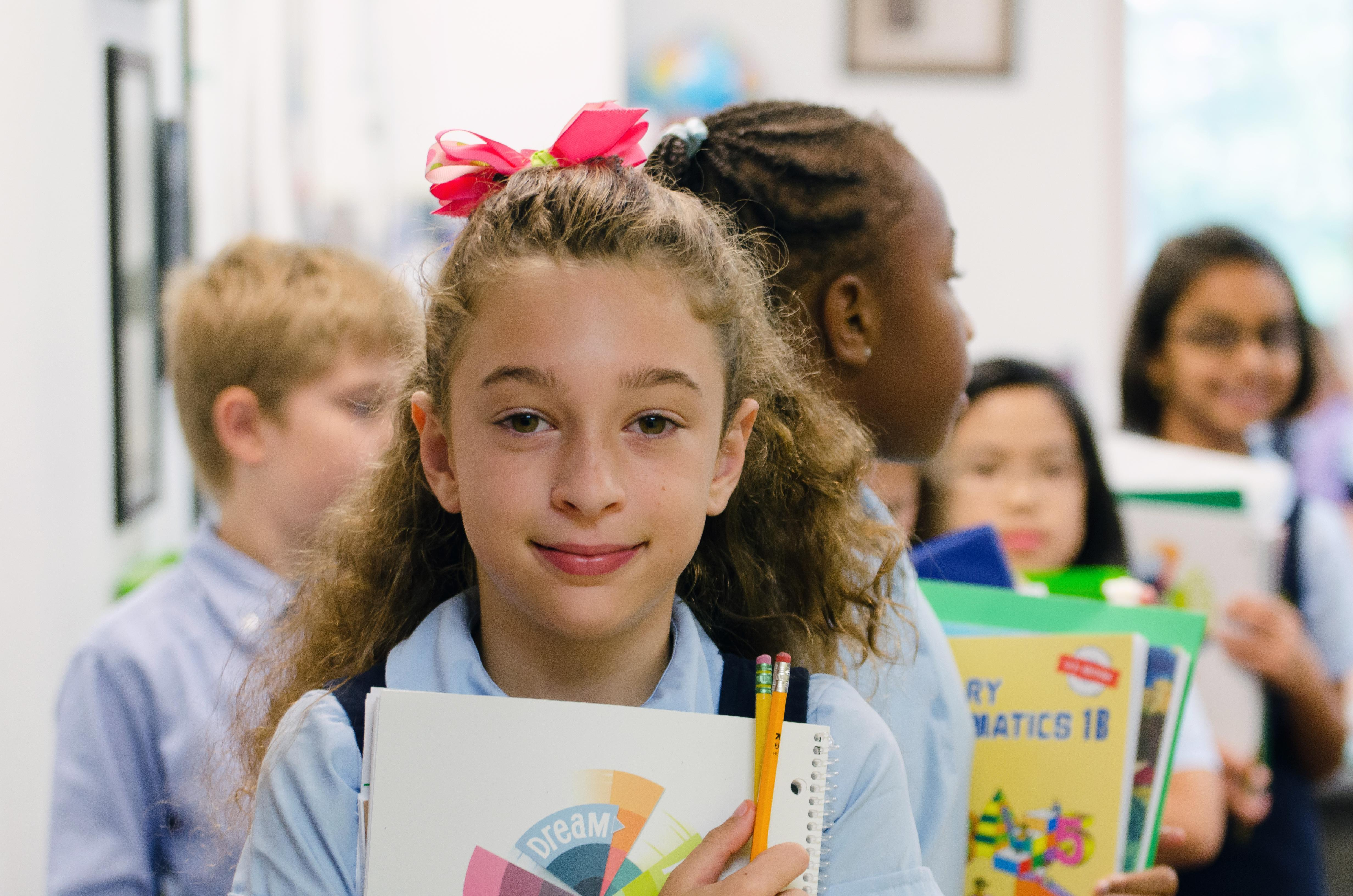 Student holding notebook