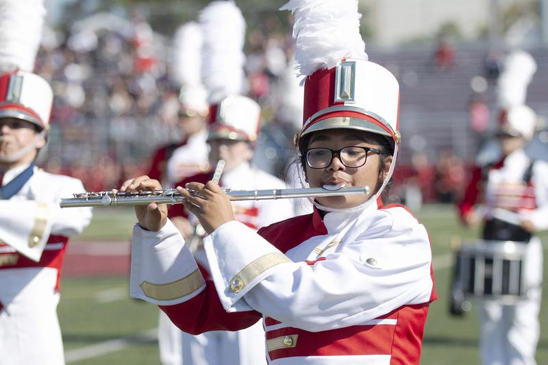 Crimson Tide band member, flute player, during an. on-field performance
