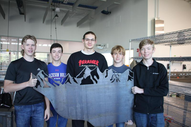 Students Holding Metal Project