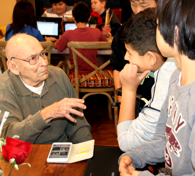 Children visiting with the elderly
