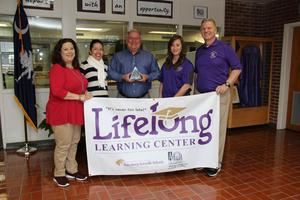 Pictured from left to right are Lifelong Learning Center employees Geena Beerman Copeland, Seira Reyes-Gonzales, Randy Fox, Kimberly Lawson and Randall Price. The LLC received the 2017-2018 Civics and Citizenship Award on Friday, February 15th.