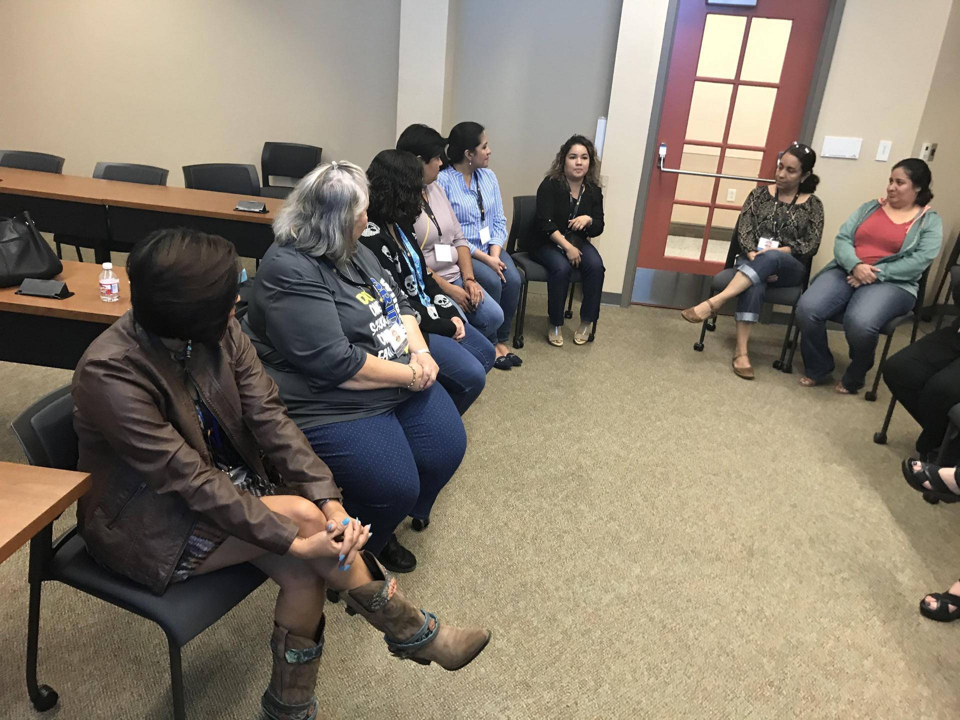 Teachers in a group circle
