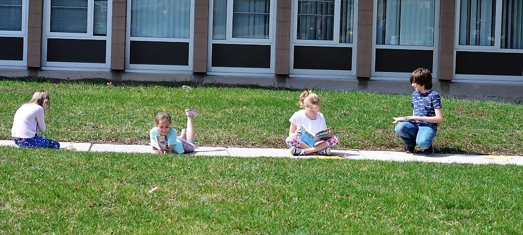 Students reading outdoors
