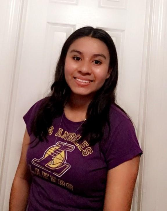 Kateryn Perez Olivos posing in her Lakers gear