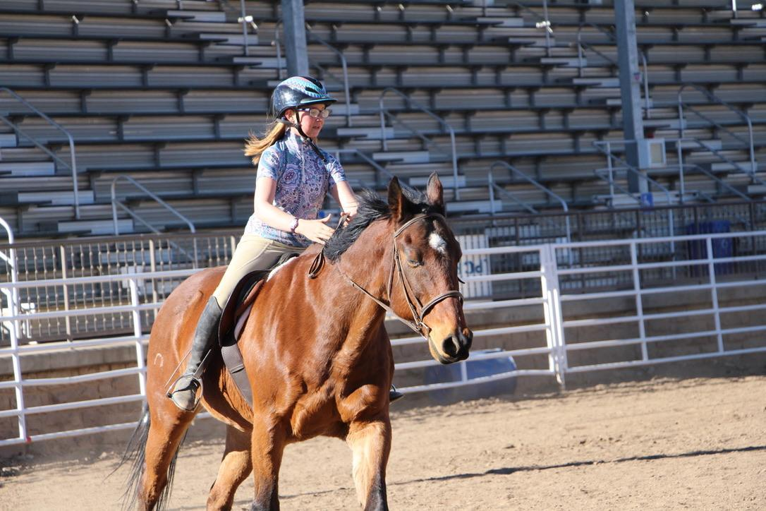 A student riding a horse