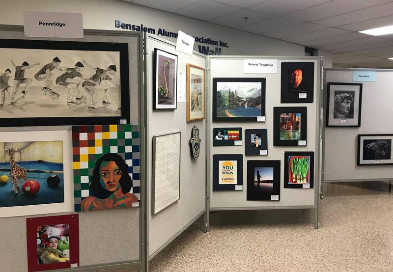 Artwork from Pennridge, Palisades, Bristol Township and Pennsbury School Districts featuring Black and white sketch of skateboarders, Giraffe on a pool table, Green dragon, and a Boy fishing.