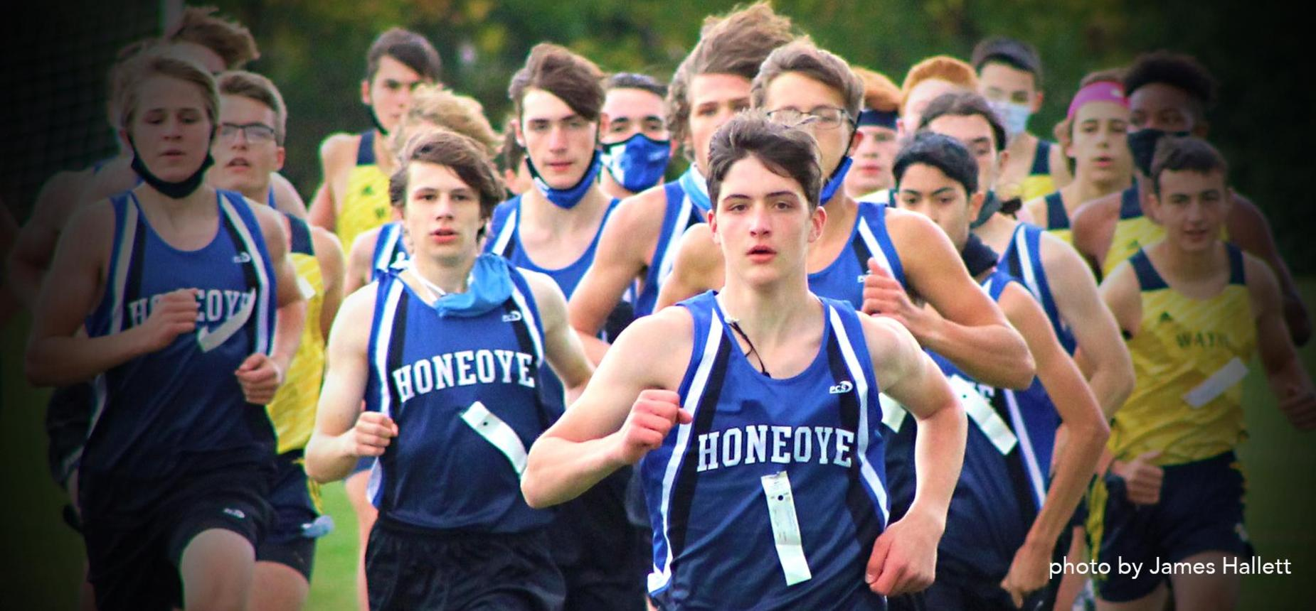 Cross country runners with Honeoye in the lead