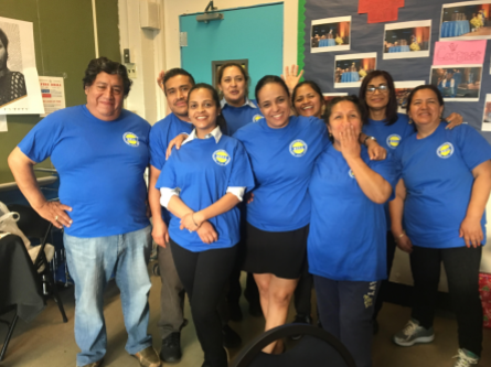 Group of parents in Blue shirts