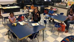 several kids enjoying coloring