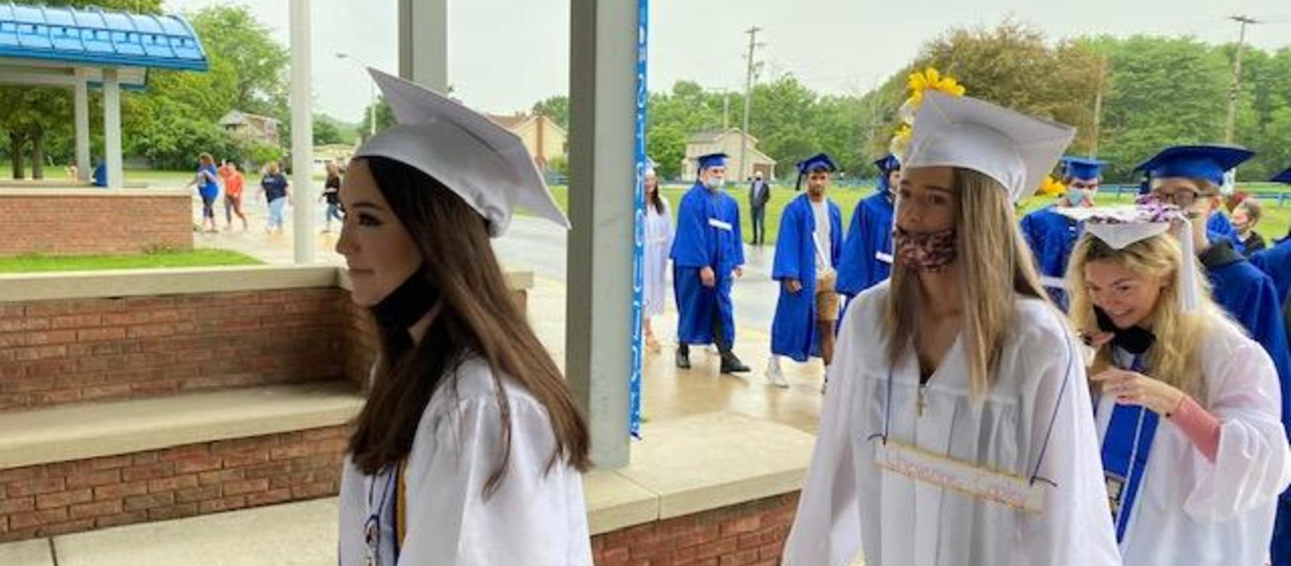 students wearing cap and gown.