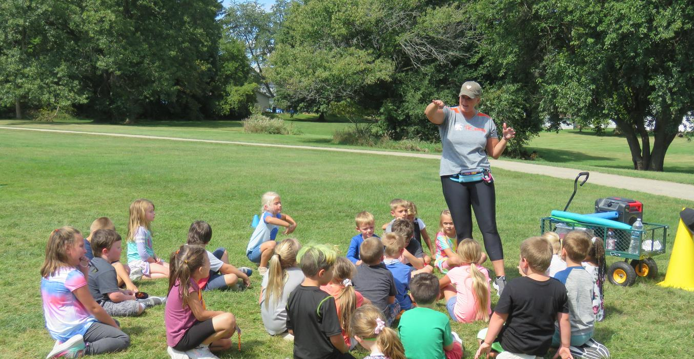 PE teacher at McFall explains the rules for a game.