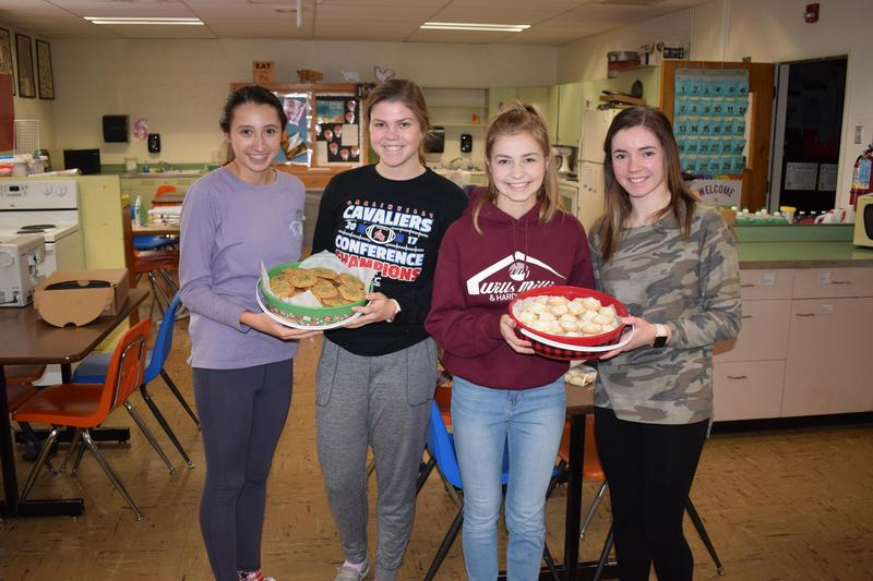 """Members of FORCE used the snow day to make cookies for """"Cocoa with a Cop."""