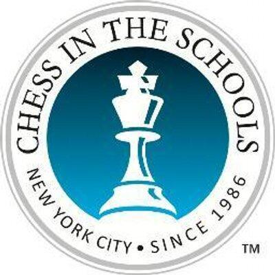 Chess in the schools logo of white king on blue background