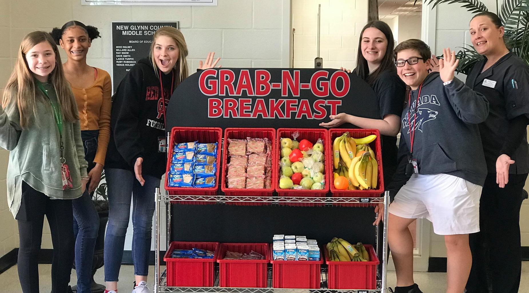 Students pose with Grab 'N Go carts.