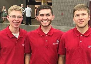 Ben Campbell is flanked by two fellow competitors at the SkillsUSA Competition.
