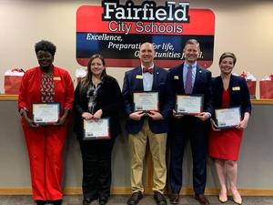 Image of the five board of education members holding recognition certificates thanking them for their service. The members are from left to right Balena Shorter, Jerrilynn Gundrum, Michael Berding, Brian Begley and Carrie O'Neal.
