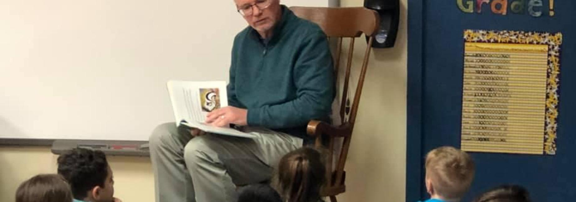 Mr. Jones reading to children
