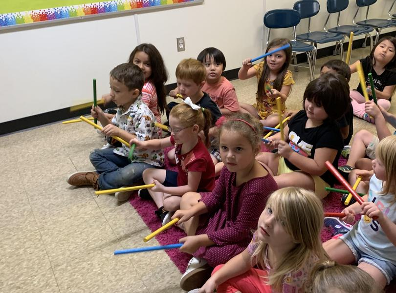 Image of student using sticks for music class