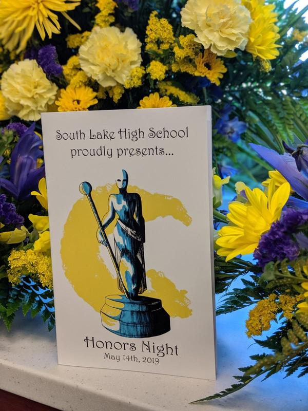 Honors Night Booklet displayed in front of flowers