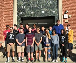 Westfield High School principal Mary Asfendis (far right) congratulations WHS seniors who received perfect scores on June 2019 SAT subject tests.  (First row, L-R) Ryan Billings, Samuel Ertman, Max Tennant, Aidan Kilbourn, Grace Endy, Mira Mehta, and Abbey Zidel.  (Back row, L-R) Spencer Rothfleisch, Thomas Lupicki, Henry Meiselman, Alan Solovey, Sivaji Turimella, Kurt Hu, Zachary Fischer, and Matthew Arndt