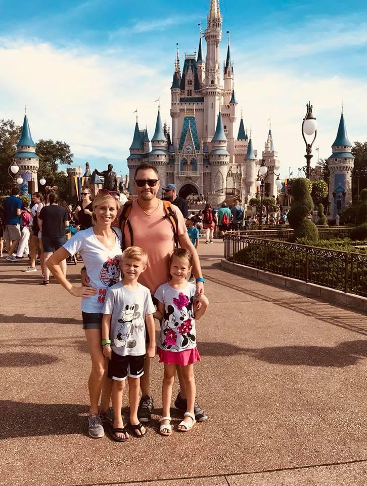 A picture of Mrs. DeNu with her husband and children at Disney World