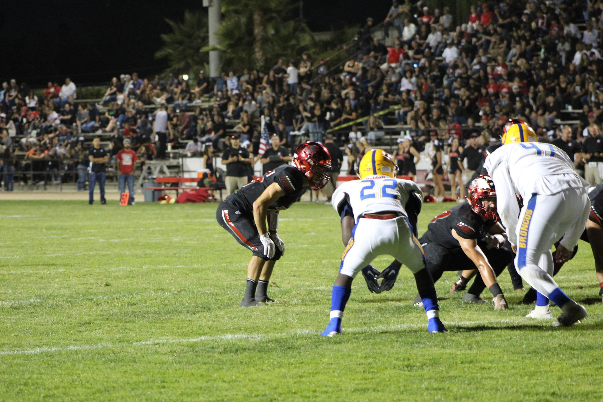 Varsity football playing against Dos Palos