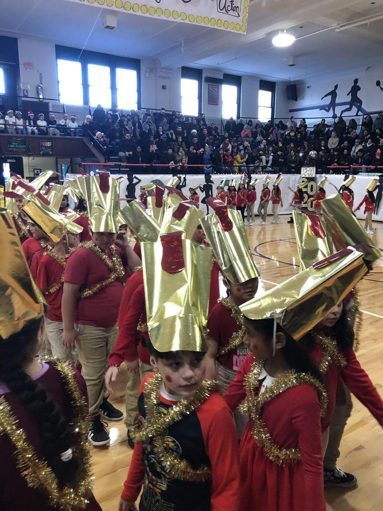children dressed as toy soldiers walking around the gym