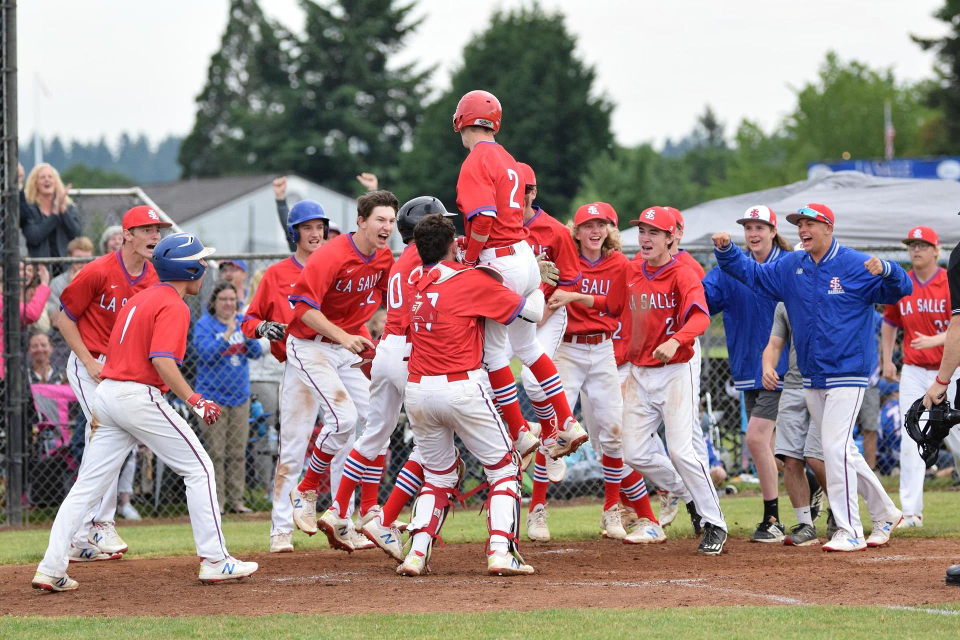 baseball team celebrates after a grand slam home run