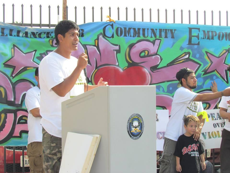 student speaks at a podium during Peace March
