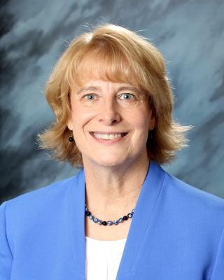 Headshot of Paula Kellerer in a blue blazer