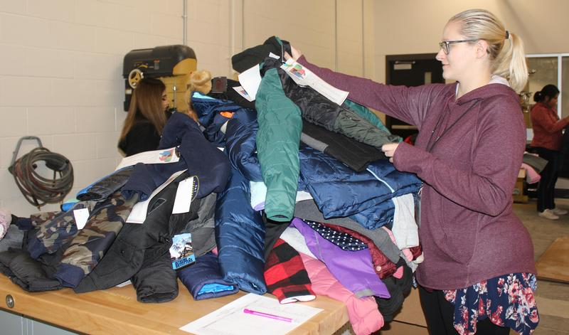 Student sorting coats