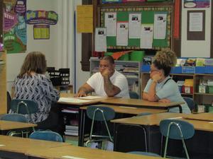 teacher talking to a set of parents