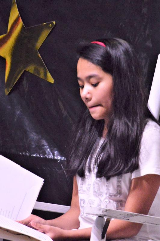 5th grade actor in Reader's Theater play.