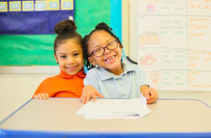 2 students smiling