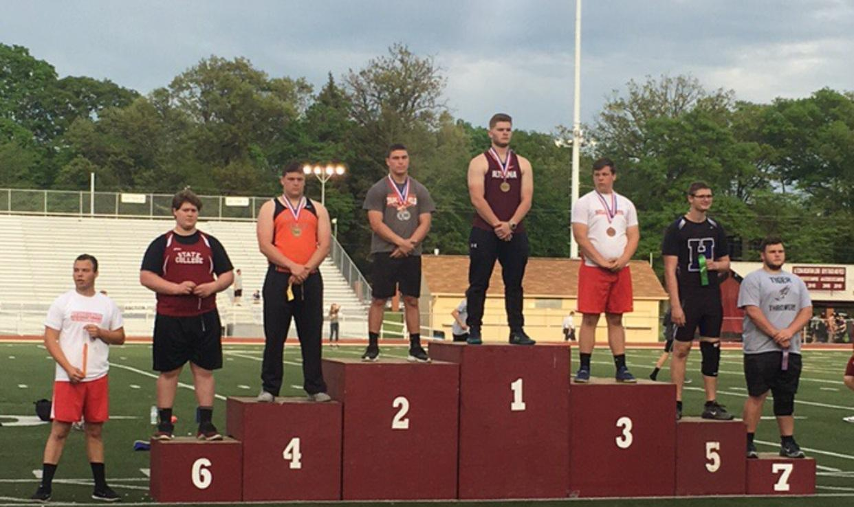 Ben Tofono on Podium District 6 Champion Shot Put