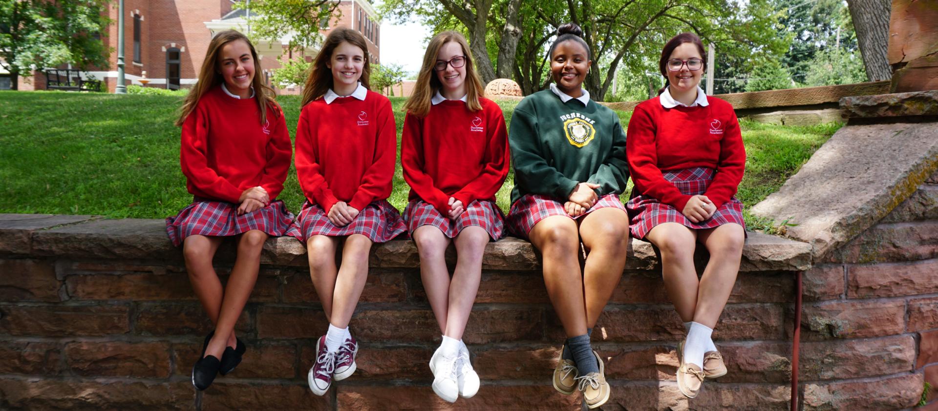 girls posed in uniforms