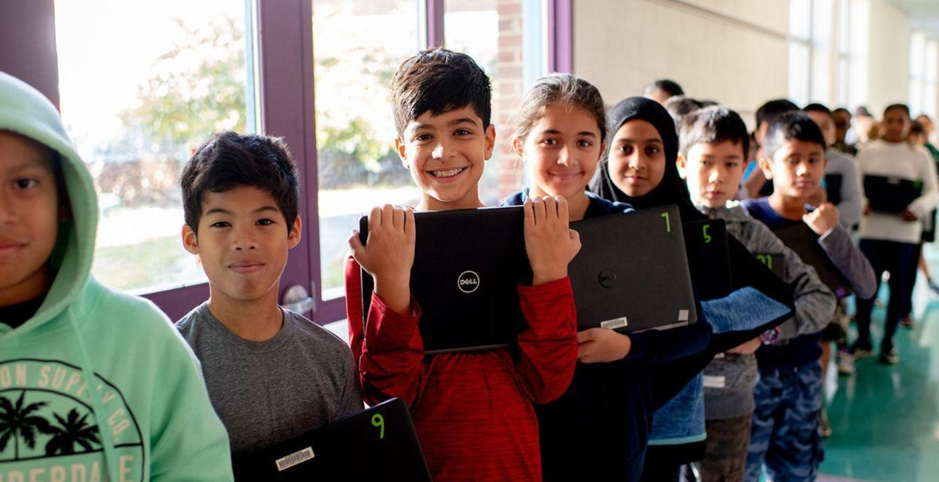 photo of kids with computers