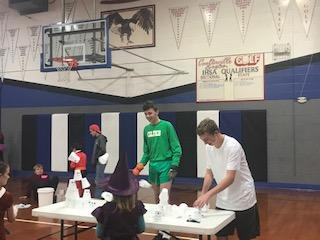 Ryan and Garrett helping at the PTT Halloween Party