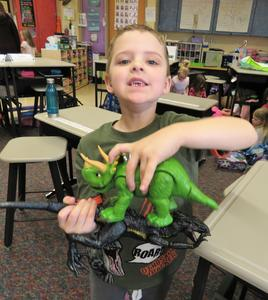 This kindergarten student shows his love of dinosaurs.
