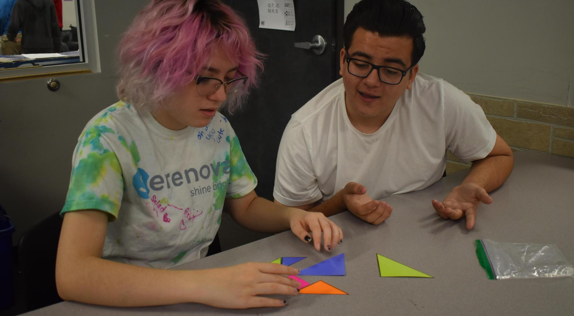 Students from House Unbroken solving math puzzle during House Olympic