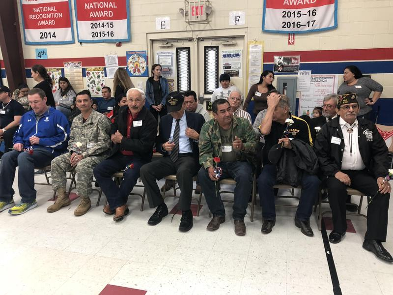 veterans sitting together at ceremony.