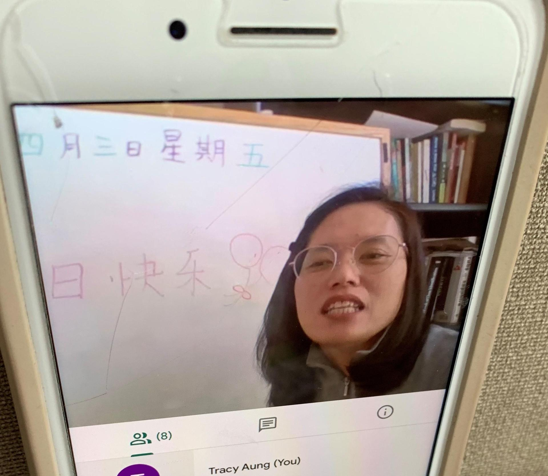 A teacher giving online instruction in Chinese